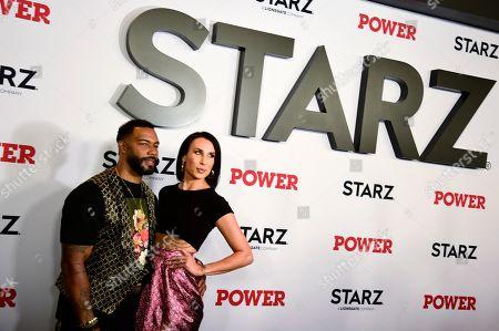 Stock Photo of Omari Hardwick and Jennifer Pfautch