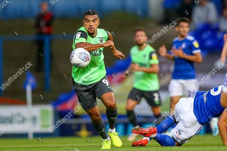 AFC Wimbledon forward Kwesi Appiah (9) goes past Ipswich Town defender James Wilson (5) during the EFL Sky Bet League 1 match between Ipswich Town and AFC Wimbledon at Portman Road, Ipswich