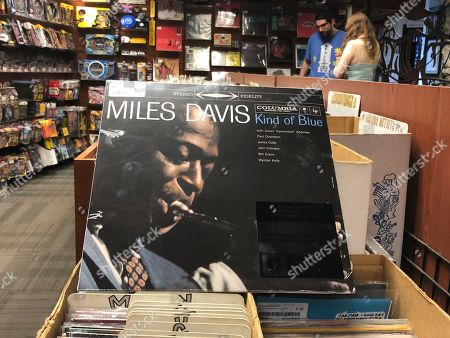 """The """"Kind of Blue"""" album cover is on display at Bull Moose record store in Portland, Maine, on the 60th anniversary of the album's release. Drummer Jimmy Cobb, the only surviving musician who performed on Miles Davis' jazz masterpiece """"Kind of Blue,"""" is still keeping time as the iconic recording marks its 60th anniversary"""