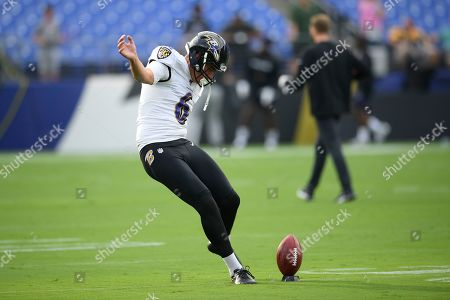 Stock Image of Baltimore Ravens punter Sean Smith warms up prior to a NFL football preseason game against the Green Bay Packers, in Baltimore