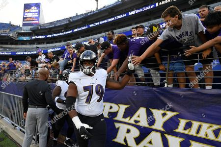 Baltimore Ravens offensive tackle Ronnie Stanley (79) takes the field prior to a NFL football preseason game against the Green Bay Packers, in Baltimore