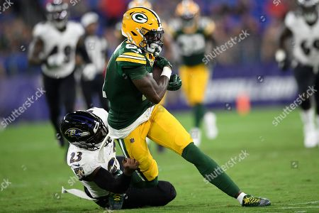 Stock Photo of Green Bay Packers wide receiver Geronimo Allison (81) is tackled by Baltimore Ravens strong safety Tony Jefferson (23) during the first half of a NFL football preseason game, in Baltimore