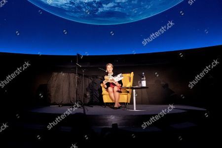 Stock Picture of Minister of Family Affairs, Senior Citizens, Women and Youth Franziska Giffey speaks during a book reading event at the Zeiss Major Planetarium in Berlin, Germany, 2019. Giffey reads the book 'The Lion Inside' by Rachel Bright to children and their parents.