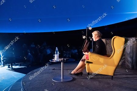 Stock Image of Minister of Family Affairs, Senior Citizens, Women and Youth Franziska Giffey speaks during a book reading event at the Zeiss Major Planetarium in Berlin, Germany, 2019. Giffey reads the book 'The Lion Inside' by Rachel Bright to children and their parents.