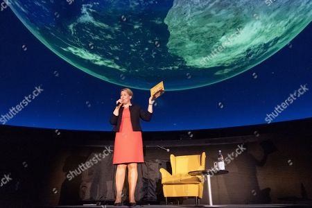 Stock Photo of Minister of Family Affairs, Senior Citizens, Women and Youth Franziska Giffey speaks during a book reading event at the Zeiss Major Planetarium in Berlin, Germany, 2019. Giffey reads the book 'The Lion Inside' by Rachel Bright to children and their parents.