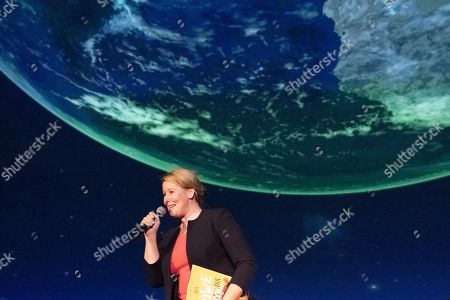 Minister of Family Affairs, Senior Citizens, Women and Youth Franziska Giffey speaks during a book reading event at the Zeiss Major Planetarium in Berlin, Germany, 2019. Giffey reads the book 'The Lion Inside' by Rachel Bright to children and their parents.