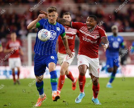 Lee Evans of Wigan Athletic tries to out run Britt Assombalonga of Middlesbrough
