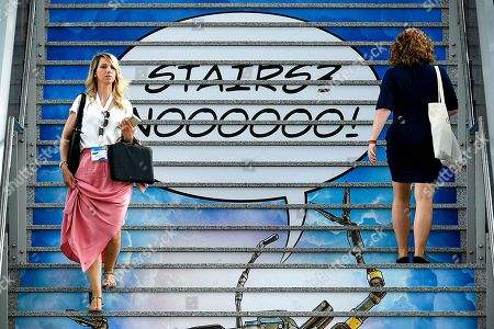 Women walk on stairs at the Gamescom convention in Cologne, Germany, 20 August 2019. The Gamescom gaming convention runs from 20 to 24 August 2019.