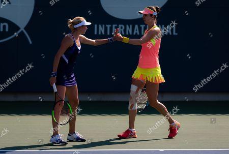 Lyudmyla Kichenok of the Ukraine and Galina Voskoboeva of Kazhakstan playing doubles
