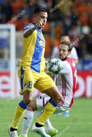 APOEL Nicosia's Lucas Souza (L) fights for the ball against Ajax Amsterdam's Daley Blind (R) during the UEFA Champions League playoff first leg soccer match between APOEL Nicosia and Ajax Amsterdam at the GSP Stadium in Nicosia, Cyprus, 20 August 2019.