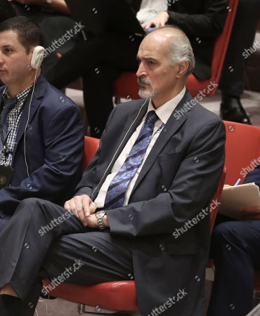 Syria United Nations Ambassador Bashar Jaafari, right, listen during a meeting of the United Nations Security Council on the Mideast, at U.N. headquarters