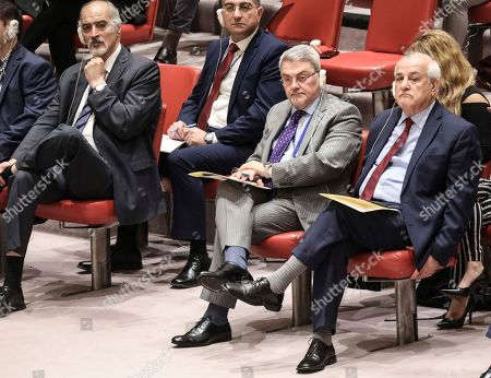 Syria United Nations Ambassador Bashar Jaafari, far left, Iraq U.N. Ambassador Mohammad Hussein Ali Bahr Aluloom, second from right, and Palestine's Permanent Observer to the United Nations Ambassador Riyad Mansour, far right, listen from the observer's seats during a meeting of the United Nations Security Council on the Mideast, at U.N. headquarters