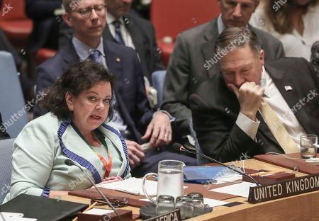 United States Secretary of State Michael Pompeo, right, istens as United Kingdom United Nations Ambassador Karen Pierce, left, address a meeting of the United Nations Security Council on the Mideast, at U.N. headquarters