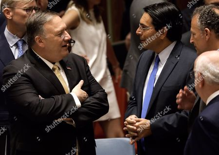 US Secretary of State Mike Pompeo (L) speaks with  Danny Danon, Israel's Permanent Representative to the United Nations at a security council meeting at United Nations headquarters in New York, New York, USA, 20 August 2019. The meeting was for the promotion and strengthening of the rule of law in the maintenance of international peace and security.