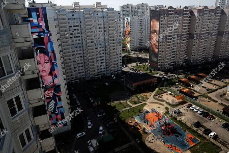 Stock Photo of A view of a graffiti depicting Yuri Gagarin (R), the first man in space, created by Italian artist Jorit Agoch at Trehgorka district in Odintsovo, near Moscow, Russia, 20 August 2019, during the Mural-Art fest Urban Morphogenesis in which 60 artists from Russia, Spain, Germany, Japan, Australia, England, France, Brazil, Canada, Indonesia, Hungary, Bulgaria, Mexico, Thailand, Italy, Portugal, Argentina, USA, China and Switzerland participate. The festival runs from 01 to 31 August.