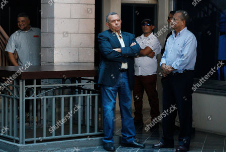 "Porfirio Lobo. Former Honduran President Porifirio Lobo waits outside the court for the arrival of his wife Rosa Elena Bonilla de Lobo before her sentencing on corruption charge in Tegucigalpa, Honduras, . The case has been dubbed ""La caja chica de la dama,"" Spanish for ""the lady's petty cash"