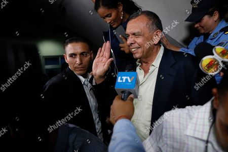 """Former Honduran President Porfirio Lobo waves to the press outside court where his wife, former first lady Rosa Elena Bonilla de Lobo, was convicted on corruption charges in Tegucigalpa, Honduras, . The court convicted the former first lady on Tuesday of embezzling about $600,000 in government money between 2010 and 2014, when her husband was president. Lobo, who is also facing a corruption probe, said, """"We do not agree with the verdict, and we will appeal"""