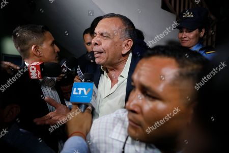 "Former Honduran President Porfirio Lobo speaks to the press outside court where his wife, former first lady Rosa Elena Bonilla de Lobo, was convicted on corruption charges in Tegucigalpa, Honduras, . The court convicted the former first lady on Tuesday of embezzling about $600,000 in government money between 2010 and 2014, when her husband was president. Lobo, who is also facing a corruption probe, said, ""We do not agree with the verdict, and we will appeal"