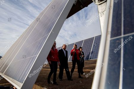 China's Xie Zhenhua, second from left, walks with Chile's Environment Minister Carolina Schmidt, third from left, and Chile's Energy Minister Juan Carlos Jobet, far left, as they tour the Quilapilún solar plant, a joint venture by China and Chile, in Colina, Chile, . Chile is highlighting their alliance with China to push for a global call to reduce global warming ahead of the global climate change summit in Santiago next December