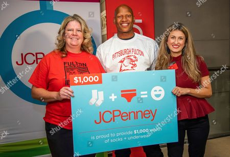 IMAGE DISTRIBUTED FOR JCPENNEY - Pittsburgh Steelers linebacker Ryan Shazier poses for a photo with Fulton Elementary School principal Karen Arnold, left, and JCPenney at Robison Town Center general manager Jill Tonti, after he surprised 24 teachers from Fulton Elementary School with a shopping spree at the Robinson Town Center JCPenney on in Pittsburgh. JCPenney is recognizing and supporting deserving teachers across the U.S. through a series of Back-to-School Giving Spree events. Throughout the month of August, JCPenney will host sprees for more than 200 teachers