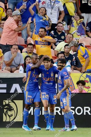 Tigres's Enner Valencia (13), Jurgen Damm (25) and Javier Aquino (20) celebrate Damm's goal during the first half of a UANL Leagues Cup semifinal against Club America, in Houston