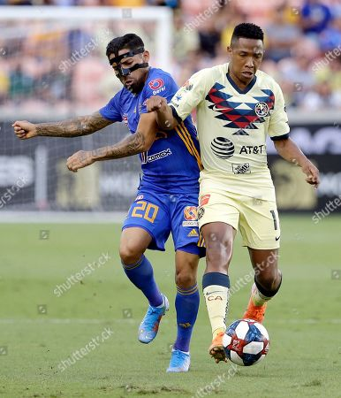Stock Picture of Tigres' Javier Aquino (20) is pushed away by Club America's Andres Ibarguen during the first half of a UANL Leagues Cup semifinal, in Houston