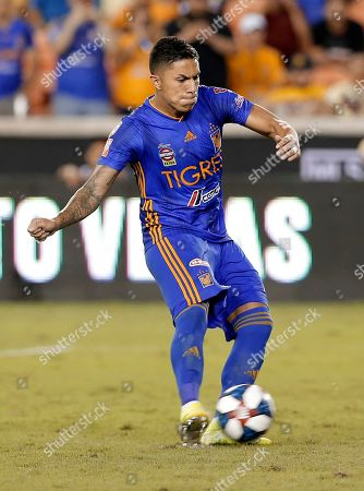Tigres' Carlos Salcedo kicks the winning goal during the tie breaker against Club America during the second half of a UANL Leagues Cup semifinal, in Houston