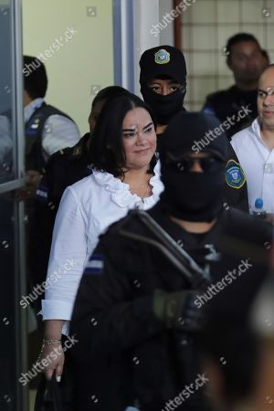 Stock Photo of Former First Lady of Honduras Rosa Elena Bonilla (L), wife of former President Porfirio Lobo (2010-2014), arrives to court in Tegucigalpa, Honduras, 20 August 2019. Bonilla was found guilty of embezzling around 600,000 US dollar in government funds while her husband Porfirio Lobo was President.