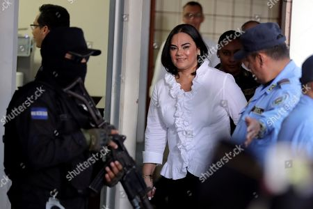 Former First Lady of Honduras Rosa Elena Bonilla (C), wife of former President Porfirio Lobo (2010-2014), arrives to court in Tegucigalpa, Honduras, 20 August 2019. Bonilla was found guilty of embezzling around 600,000 US dollar in government funds while her husband Porfirio Lobo was President.