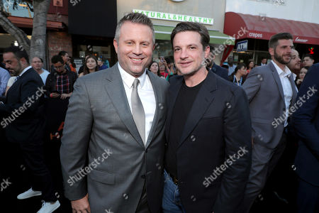 Stock Image of Ric Roman Waugh, Writer/Director, Damon Wolf, Lionsgate Motion Picture Group Marketing President,