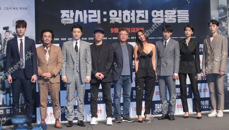 South Korean actors/cast members Kwak Si-yang, Kim In-kwon, Kim Myung-min, South Korean directors Kim Tae-hoon, Kwak kyung-taek, US actress/cast member Megan Fox, South Korean actors/cast members Kim Sung-cheol, Lee Ho-jung and Lee Jae-wook pose for a photograph during a press photo call for the movie 'Battle of Jangsari' at Apgujeong CGV Cinema in Seoul, South Korea, 21 August 2019. The movie will open in South Korean theaters on 25 September.