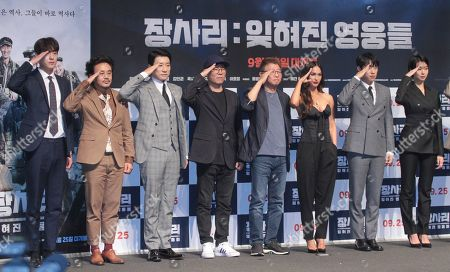 Stock Picture of South Korean actors/cast members Kwak Si-yang, Kim In-kwon, Kim Myung-min, South Korean directors Kim Tae-hoon, Kwak kyung-taek, US actress/cast member Megan Fox, South Korean actors/cast members Kim Sung-cheol and Lee Ho-jung pose for photo during a press photo call for the movie 'Battle of Jangsari' at Apgujeong CGV Cinema in Seoul, South Korea, 21 August 2019. The movie will open in South Korean theaters on 25 September.