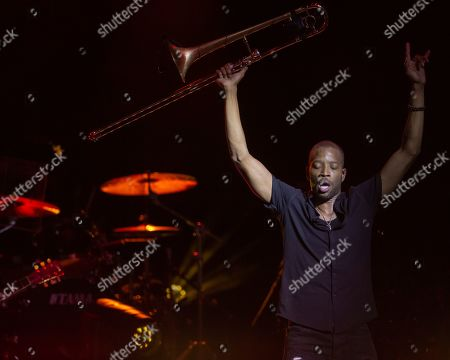 Trombone Shorty & Orleans Avenue perform on stage during their co-headlining tour with Ben Harper & The Innocent Criminals at the MECU Pavilion, in Baltimore