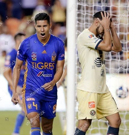 Hugo Ayala, Bruno Valdez. Tigres' Hugo Ayala (4) and Club America's Bruno Valdez, right, react to Tigres' score in the final seconds to tie the game, forcing a penalty shootout, during the second half of a UANL Leagues Cup semifinal, in Houston