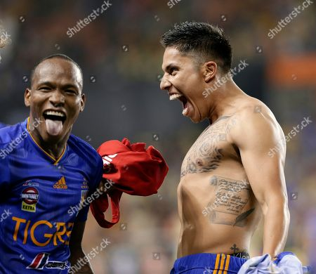 Luis Quinones, Carlos Salcedo. Tigres' Luis Quinones, left, and Carlos Salcedo, right, celebrate Salcedo's game winning goal during the penalty shootout against Club America after a UANL Leagues Cup semifinal, in Houston