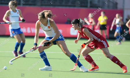 England's Giselle Ansley, left, vies for the ball against Belarus' Ulyana Kasaburskaya during a women's European Championship field hockey match between Belarus and England at the Wilrijkse Plein, Antwerp, Belgium