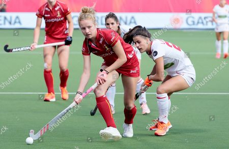 Belgium's Emma Puvrez, left, vies for the ball against Spain's Lucia Jimenez during a women's European Championship field hockey match between Spain and Belgium at the Wilrijkse Plein, Antwerp, Belgium