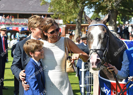 (L-R) Johnno and Toby Balding, the trainers sons with Anna Lisa Balding, his wife, after Shine So Bright, ridden by James Doyle had won The Sky Bet City of York Stakes.