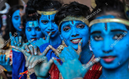 Stock Picture of Indian college girls dressed as Lord Krishna pose for photograph during Janamashtami festival celebrations at Shreemati Nathibai Damodar Thackersey (SNDT) college in Mumbai, India, 21 August 2019. Janamashtmi is celebrated as the birth anniversary of Lord Krishna.