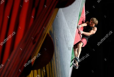 Alexander Megos of Germany competes in the bouldering event of the men's combined final at the IFSC Climbing World Championships in Hachioji, Tokyo suburbs, Japan, 21 August 2019.