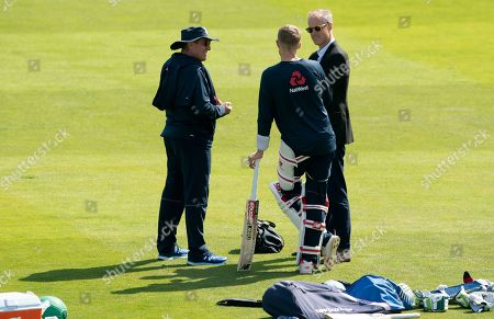 England's coach Trevor Bayliss, left, and national selector Ed Smith, right, talk with England's captain Joe Root, centre, during a nets training session at Headingley cricket ground in Leeds, England . England will play Australia at Headingley in the third Ashes test match, starting on Thursday Aug. 22