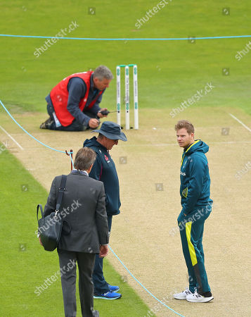 LEEDS, ENGLAND. 22 AUGUST 2019:  Mark Nicholls, Trevor Bayliss Head Coach of England and Steve Smith of Australia discuss the pitch during day one of the 3rd Specsavers Ashes Test Match, at Headingley Cricket Ground, Leeds, England.