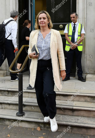 Amber Rudd, Secretary of State for Work and Pensions, leaves the Cabinet Office.
