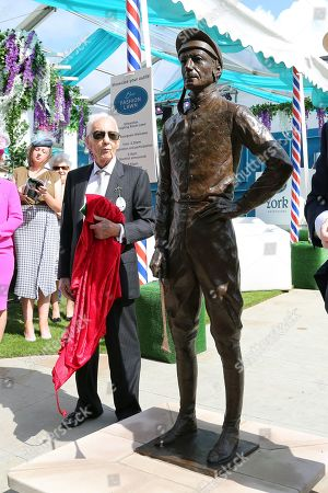 The great Lester Piggott unveils a life size bronze statue by sculptor William Newton outside the Edwardian Weighing Room  during the Ebor Festival at York Racecourse, York