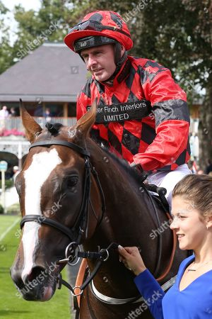 VALDERMORO (8) ridden by Tony Hamilton and trained by Richard Fahey enter the Winners Enclosure after winning The Group 3 Tattersalls Acomb Stakes over 7f (£100,000) during the Ebor Festival at York Racecourse, York