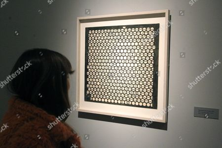 A woman looks at one of the works of Argentine artist Julio Le Parc at his exhibition in Buenos Aires, Argentina, 20 August 2019 (issued 21 August 2019). The Fine Arts Museum in Buenos Aires presents some of the works of the artist between 1955 and 1959, before his depart to Paris where his way of understanding arts changed completely.