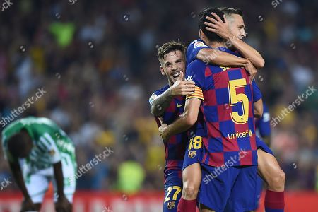 Jordi Alba of FC Barcelona celebrates his goal (4-1) with his teammates Carlos Perez and Sergio Busquets