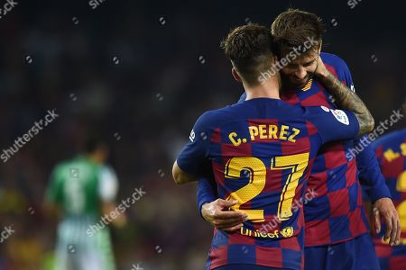 Carlos Perez of FC Barcelona celebrates the 3-1 with his teammate Gerard Pique