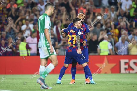 Arturo Vidal of FC Barcelona celebrates his goal (5-1) with his teammate Carlos Perez