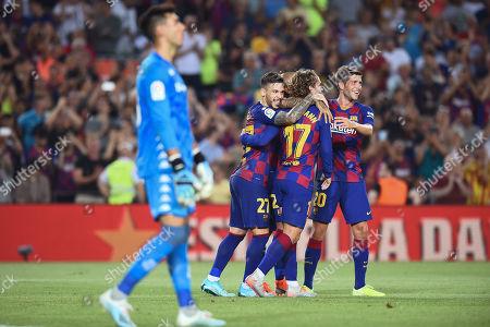 Arturo Vidal of FC Barcelona celebrates his goal (5-1) with his teammates Sergi Roberto, Antoine Griezmann and Carlos Perez